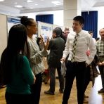Group listening as student presents his poster at 2018's Research Days